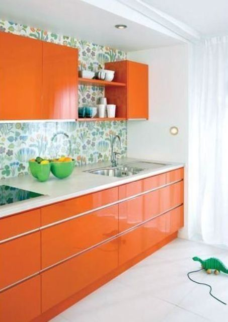 modern orange kitchen with a floral backsplash looks cute and cheerful