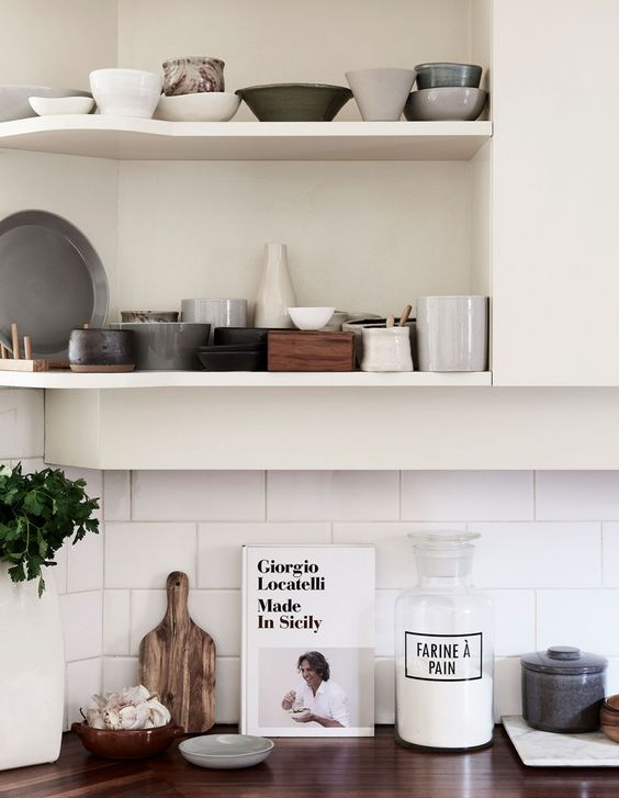 The shelves show off a ceramics collection gathered by one of the owners