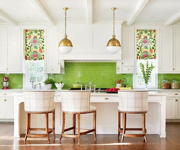a neutral kitchen is spurced up with colorful roman shades and a bold green tile backsplash