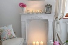 06 warm up your space with a faux fireplace with candles inside it and on it