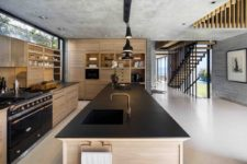 07 The ceilings are left exposed and unfinished and their ruggedness is balanced out by all the wood