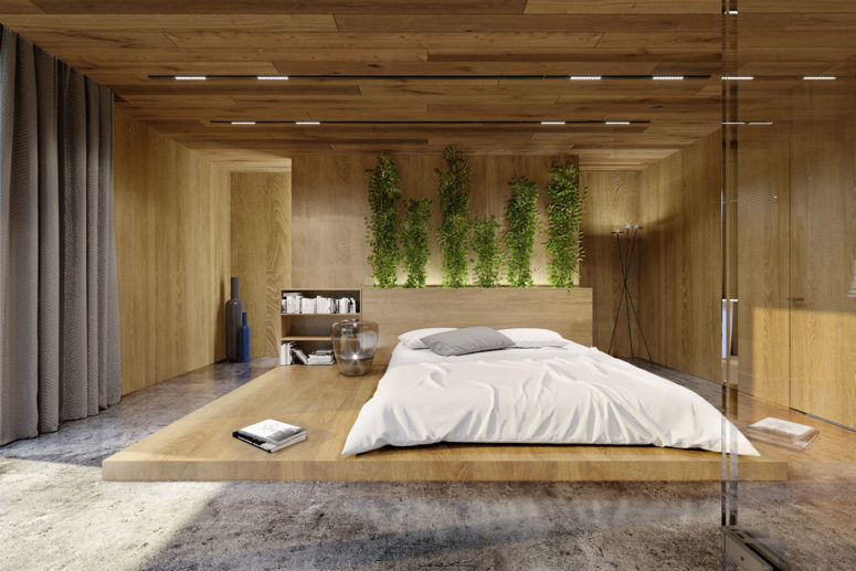 The master bedroom is done with concrete, oak panels, greenery and lots of lights
