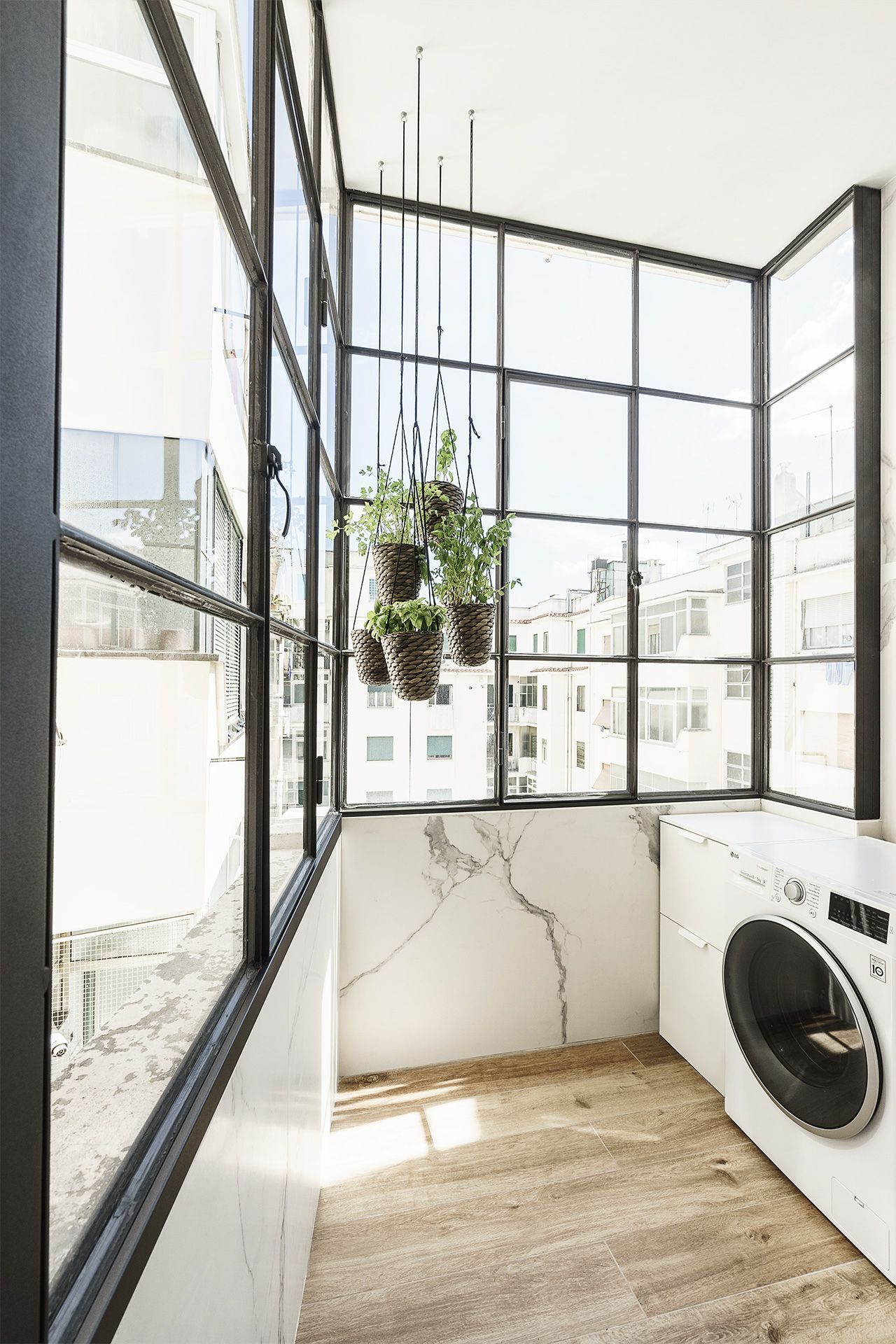 This lovely laundry room is filled with light and greenery as all the rest of the spaces