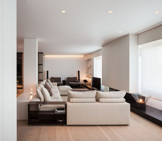 a comfy neutral space is spruced up with dark-colored furniture