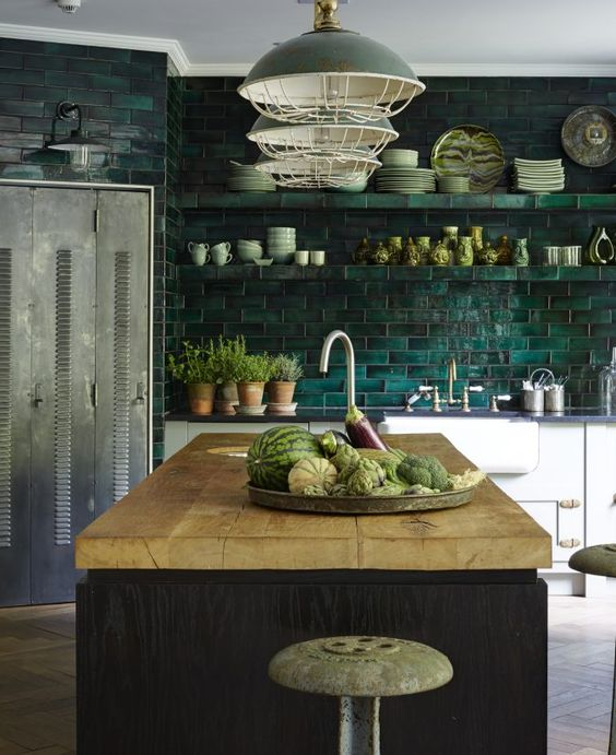 a dark green tile backsplash is extended on the whole wall, and green lamps echo it
