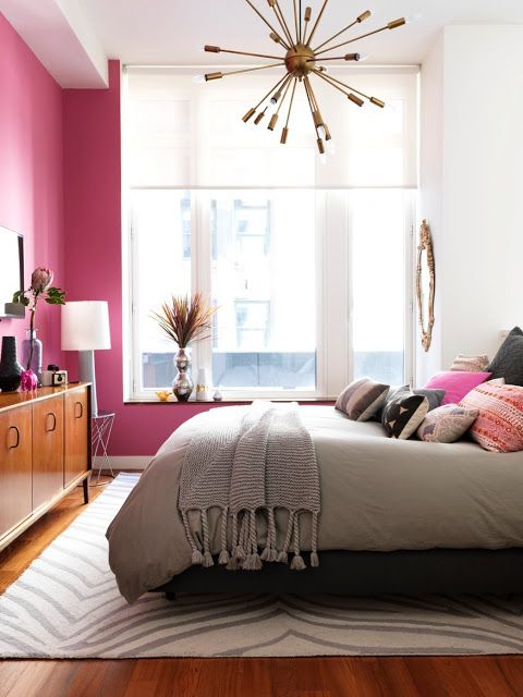 a girlish bedroom with a hot pink wall to make it look more playful