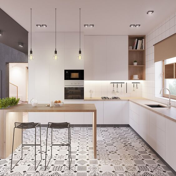 a modern space with white cabinets, wooden counters and a kitchen island and a cool mosaic tile floor