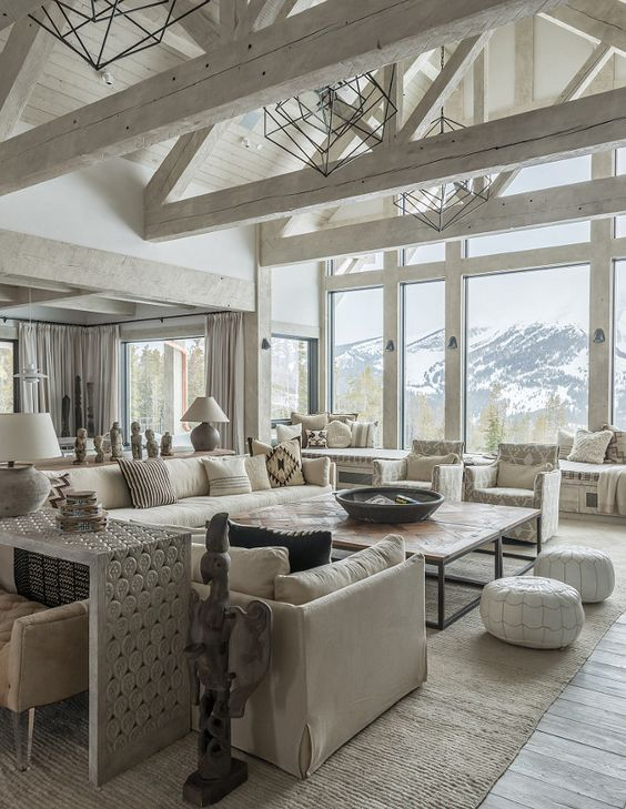 a neutral open space with a high vaulted ceiling with whitewashed beams