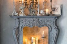 07 a vintage fireplace like this one can become an eye-catchy part of the decor, add more candles