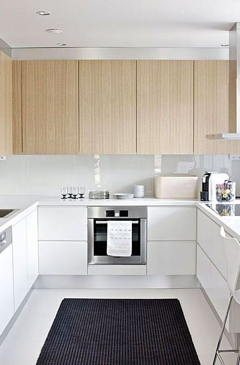 make your U shape kitchen more eye-catchy with light-colored hanging cabinets and white ones