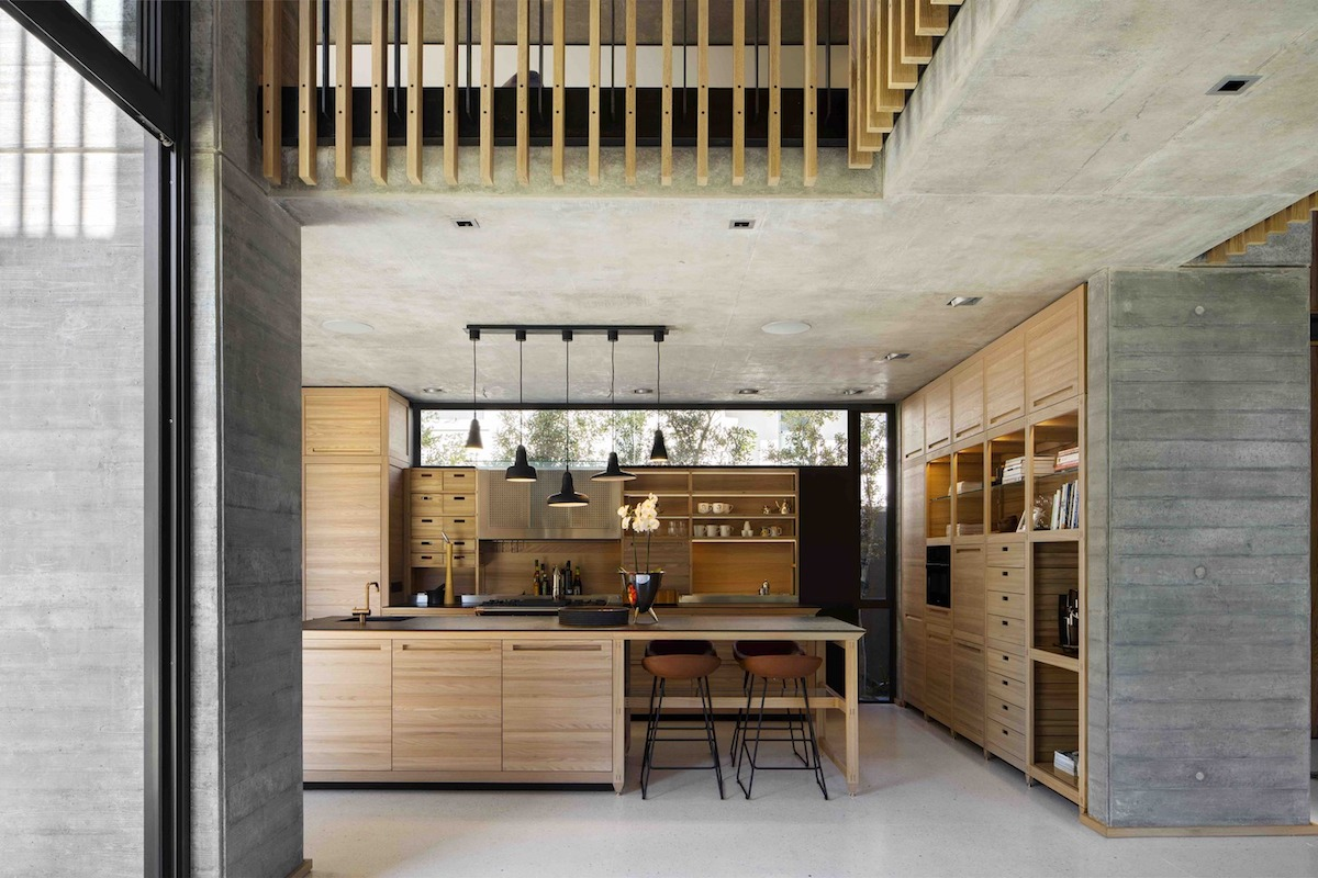 The kitchen has a clerestory window that brings natural light inside without taking up valuable space on the wall