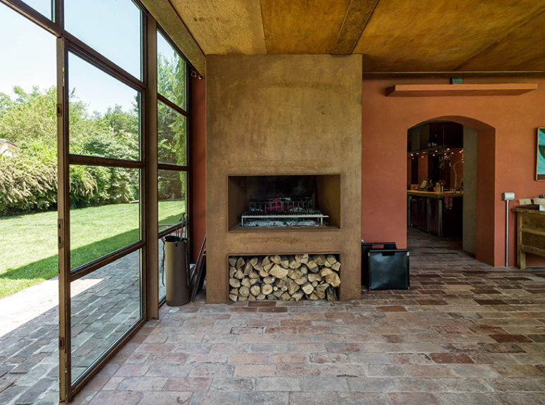 There's a real working fireplace with wood storage, which adds coziness and a homey feel