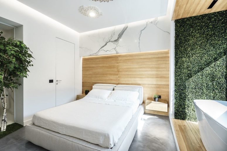 Touches of natural wood add to the relaxing nature of the bedroom