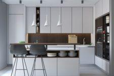 08 a modern white kitchen with a dark wood backsplash and a kitchen island with storage
