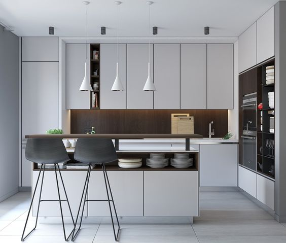a modern white kitchen with a dark wood backsplash and a kitchen island with storage