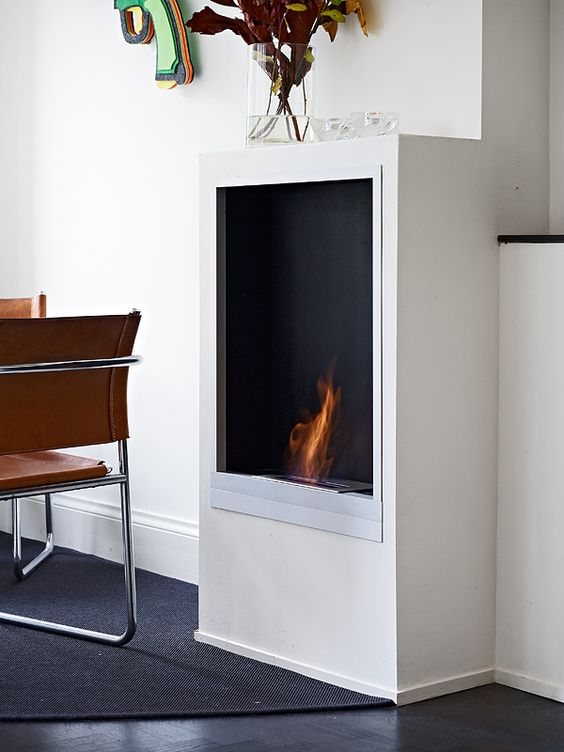 a stylish ethanol fireplace is a great idea to add coziness and warmth to your space