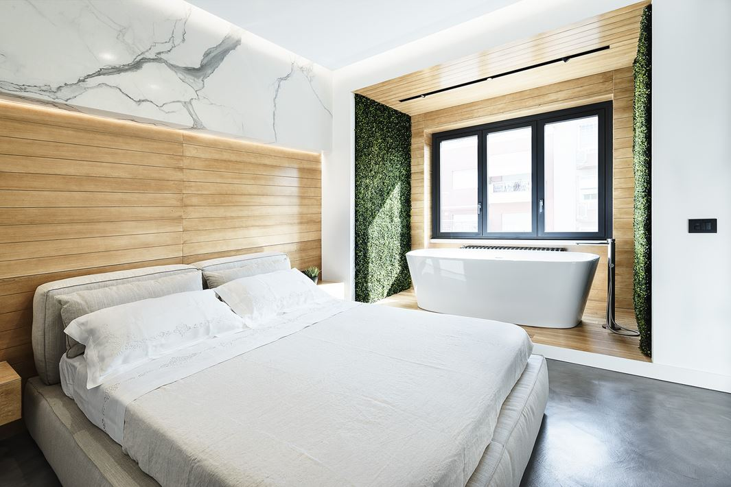 The bathtub alcove is very different and makes the most of the stunning view out the window