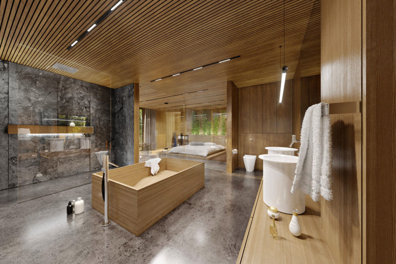 The master bathroom is very large, natural wood gives it a spa feel