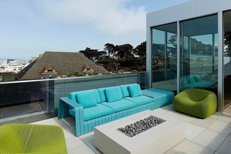 The modern terrace features cool edgy furniture in turquoise and bold green