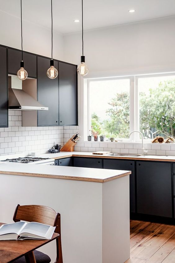 a U shaped kitchen is a nice idea for an open layout because it divides the space naturally