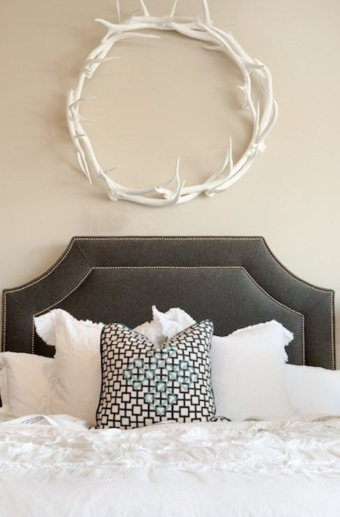 a cute antler wreath over the bed is a cool way to add a cozy feel to your space