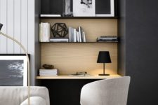 09 a small workspace with built-in shelves in perfectly integrated into the living room