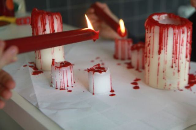 candles dripping blood are a simple and cool touch to a vampire party space