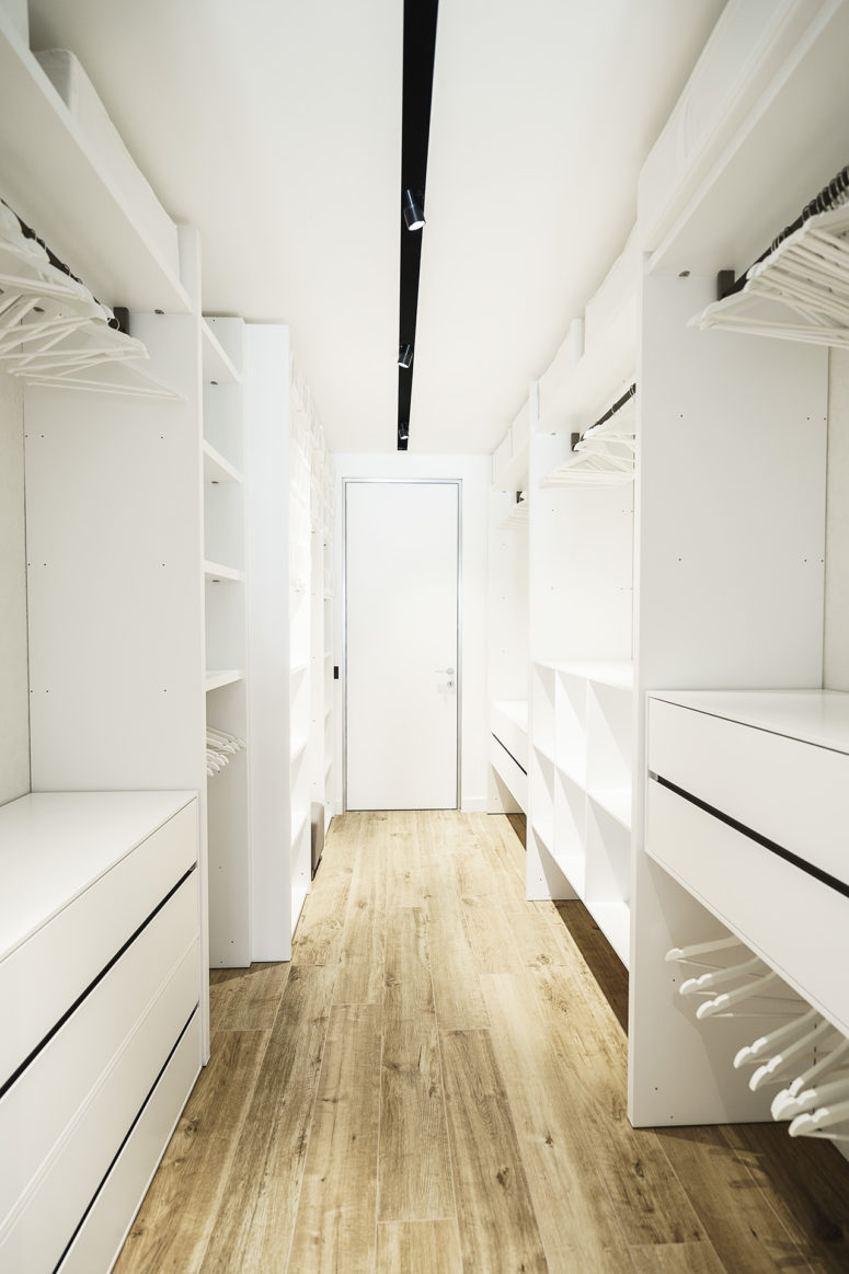 The closet is spacious and well organized, it's done in pure white
