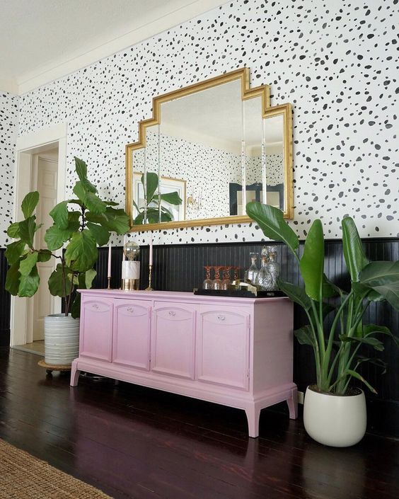 a light pink sideboard makes a colored statement in this art deco space