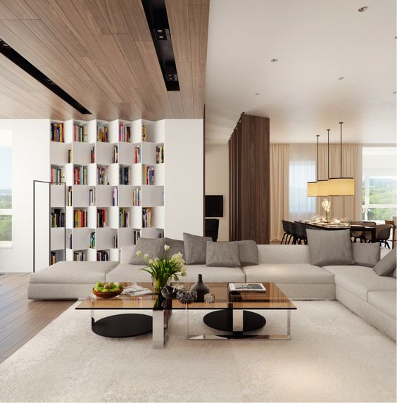 a modern neutral space with a wood clad ceiling, an eye-catchy storage unit and a chic glass table