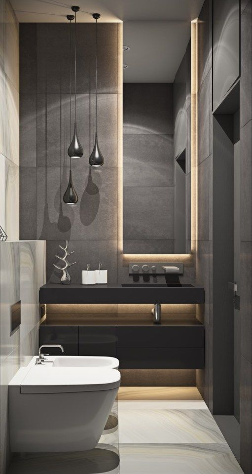 a moody modern bathroom with grey tiles, a black vanity, black pendant lamps and lit up furniture