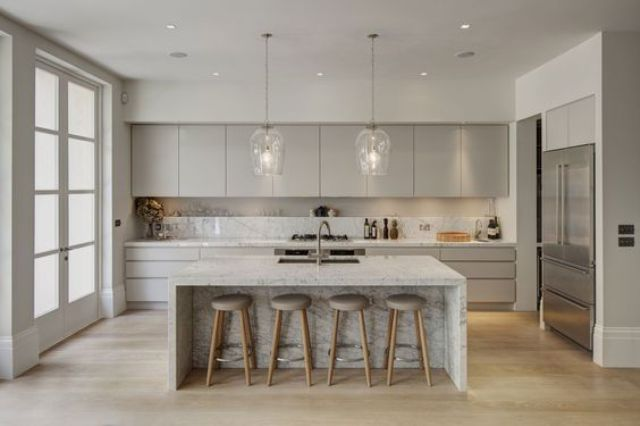 modern dove grey kitchen with white parts, a white kitchen island and a marble backsplash looks luxurious