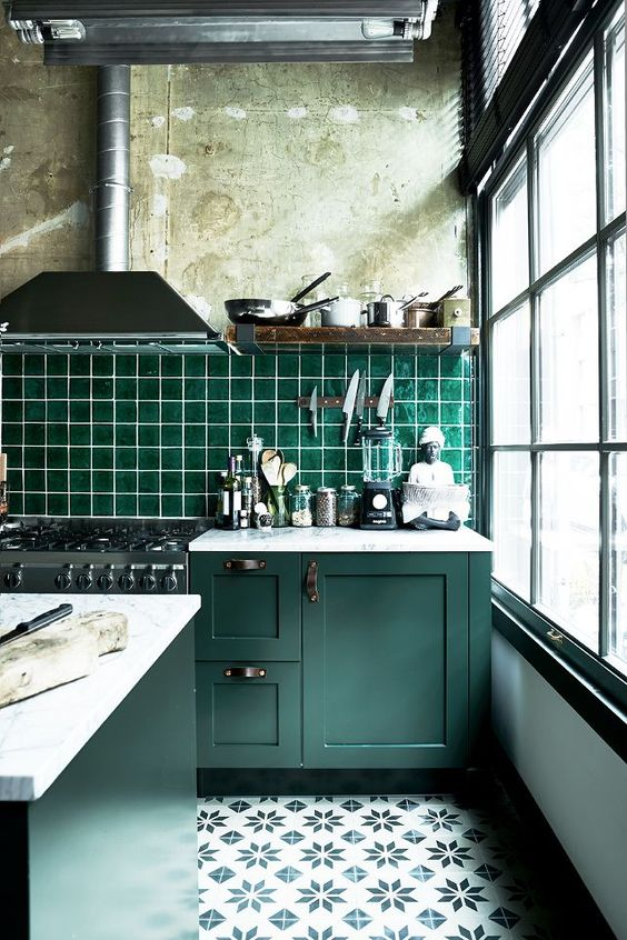 vintage dark green cabinets with industrial handles and an emerald tiles backsplash