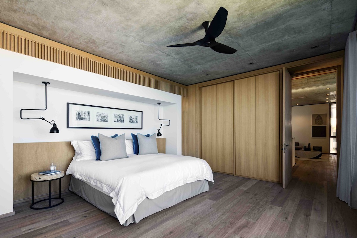 The bedroom suites are serene and simple, featuring a minimalist palette of colors