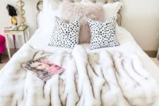 11 a faux fur pillow and bedspread is a nice idea not only to keep you comfy but also to add glam to your space
