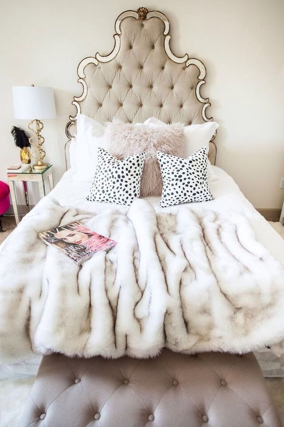 a faux fur pillow and bedspread is a nice idea not only to keep you comfy but also to add glam to your space