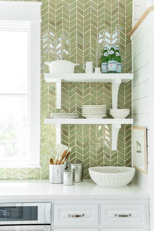 White Cabinets Are Paired With White Quartz Countertops And A Ceiling  Height Green Herringbone Tiled Backsplash