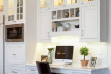 12 a kitchen with clerestory cabinets and a small workspace integrated