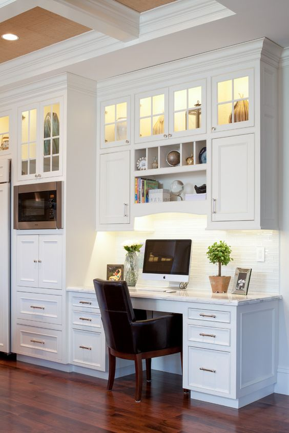 a kitchen with clerestory cabinets and a small workspace integrated