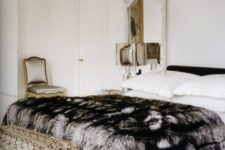 12 an elegant faux fur blanket adds a textural touch to your space