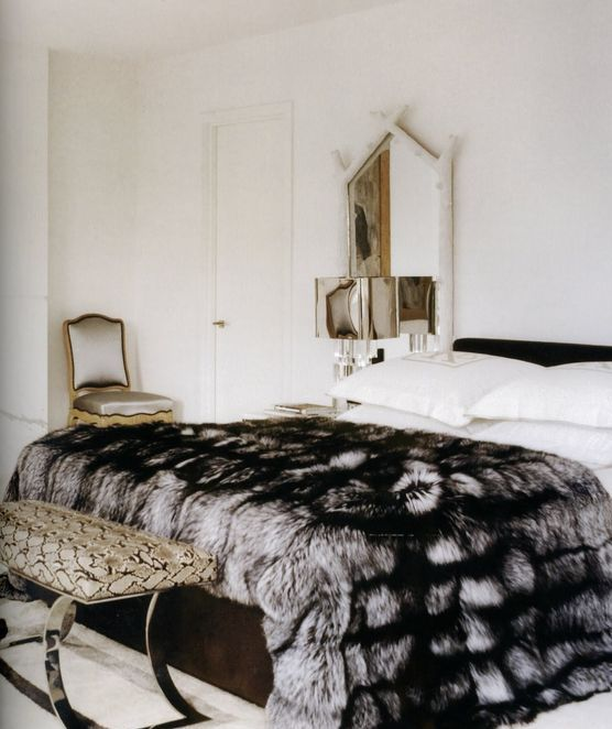 an elegant faux fur blanket adds a textural touch to your space