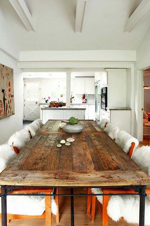 an upcycled wood door turned into a dining table makes a statement in this modern space