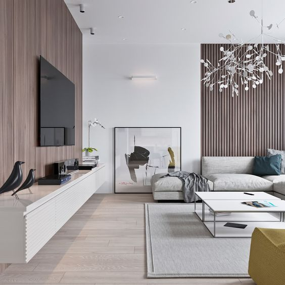 two wooden walls make a statement in this neutral room, and unique lights add interest