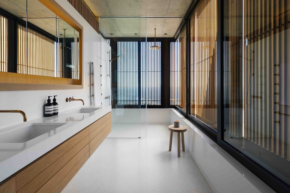 The private volumes of the house are sheltered by privacy screens that block unwanted views