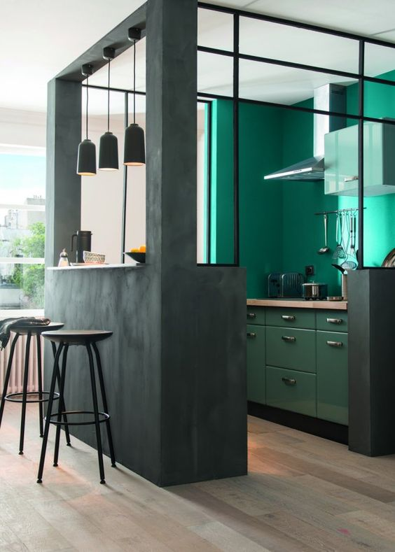 a bold green kitchen corner with turquoise walls for a colorful touch and good mood