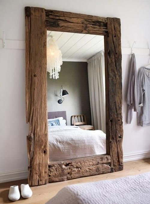 a large mirror with a reclaimed wood frame is a real chic statement that catches an eye and brings coziness
