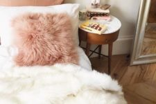 13 a pink faux fur pillow and a white blanket to add a girlish feel and comfort to the bedroom
