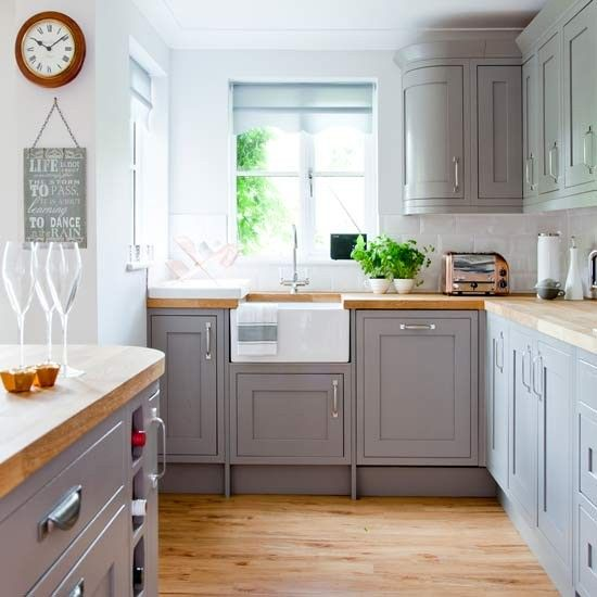 vintage farmhouse grey kitchen is refreshed with white details and nickel handles