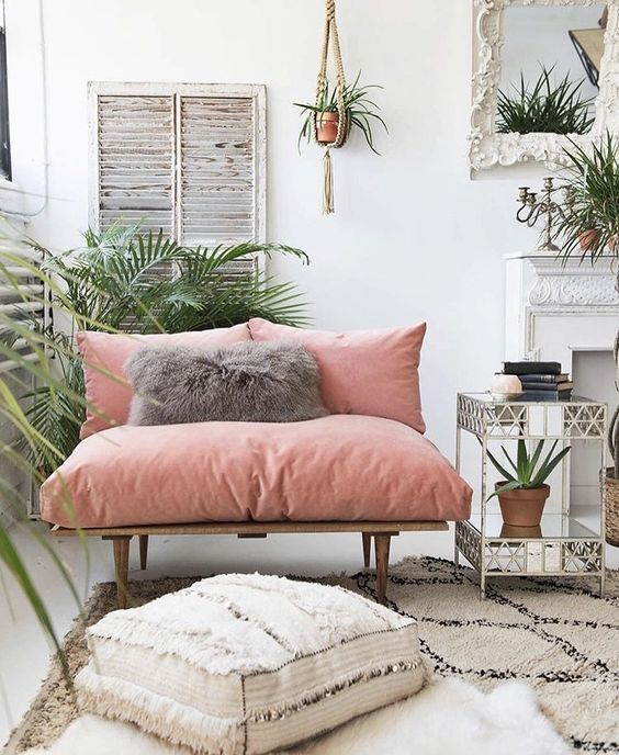 a chic loveseat with pink upholstery makes a colorful statement in the space