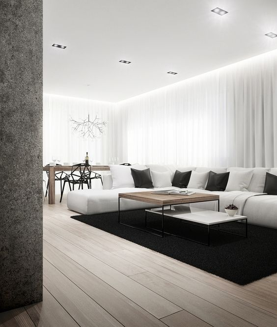a clean living space united with a dining room, lots of white keeps the space lighter